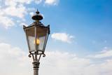 Detail of german streetlamp with sky in background and copyspace - 244022700