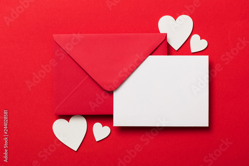 fototapeta na ścianę Valentine's day love letter mockup. Red envelope blank white card and hearts