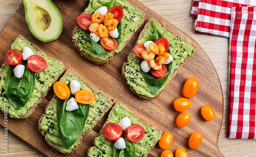 Tomato and cheese with avocado souce on the bread