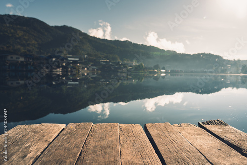 closeup wood with Blur Rivers and villages Background - 244034932