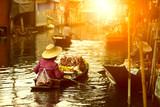 thai fruit seller sailing wooden boat in thailand tradition floating market - 244038573