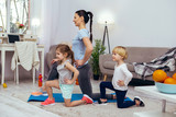Positive nice active family doing sport together - 244043157