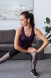 selective focus of beautiful concentrated sportswoman doing lunges at home