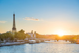 Beautiful sunset with Eiffel Tower and Seine river in Paris, France