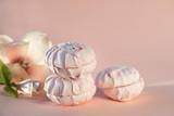 delicate fruit marshmallow, Magnolia flower on beige background, delicate dessert