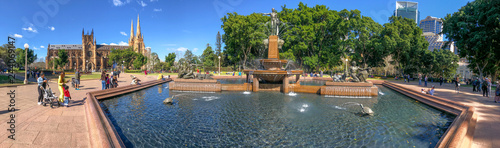 SYDNEY, AUSTRALIA - AUGUST 19, 2018: Locals and tourists enjoy Archibald Fountain in Hyde Park. This is a major destination in Sydney