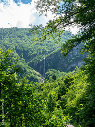Majestic views of the green mountains with the highest waterfall - 244073381