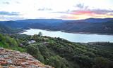 Fototapeta Zachód słońca - Guadarranque Reservoir at sunset seen from the castle of Castellar de la Frontera, Natural Park of Alcornocales, Cadiz province, Spain © joserpizarro