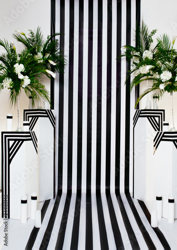 fototapeta na ścianę two vases with flowers on a black and white striped background