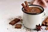 Homemade hot chocolate in a white enamel mug.