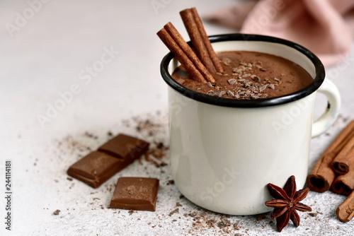Leinwandbild Motiv Homemade hot chocolate in a white enamel mug.