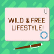 Handwriting text Wild And Free Lifestyle. Concept meaning Freedom natural way of living outdoor activities Blank Square Color Board with Magnet Click Ballpoint Pen Pushpin and Clip