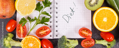 Word diet written in notepad and fruits with vegetables, healthy lifestyles concept