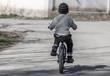 A boy rides a bike on the road