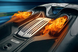 Supercar engine exhaust with a fire flame. Car ride fast at the tunnel at night