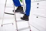 Man Stepping On Ladder - 244173741