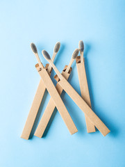 Bamboo biodegradable toothbrushes on blue
