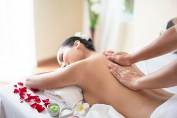 Young woman at spa massage © Witthaya