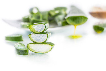 Slices of aloe vera with gel on white background © weyo