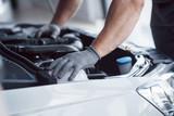 Auto mechanic working in garage. Repair service - 244185511