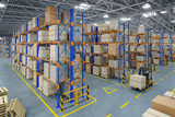 Forklift truck in warehouse or storage and shelves with cardboard boxes. - 244199767