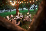 Outdoor restaurant. Prepared desk waiting for food and visitors. Evening time - 244204770
