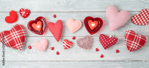 Valentine's day banner background with heart shapes and candles. © maglara