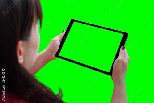 Woman holding tablet with isolated screen in horizontal position. Isolated in green, chroma key. - 244210397
