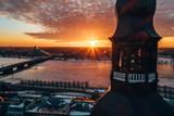 Fototapeta Zachód słońca - Beautiful view of the Riga old town during sunny winter day. © ingusk