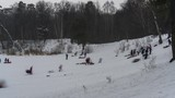 A lot of people go down the snow hill in the Park on a winter day off,time lapse - 244241545