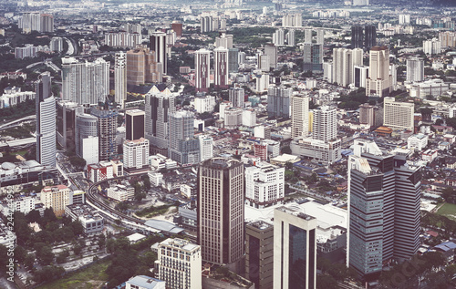 Fridge magnet Kuala Lumpur cityscape on a rainy day, color toned picture, Malaysia.