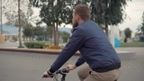 Lonely man is working out in daytime, riding a bike in summer - 244253508
