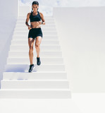 Fitness woman doing workout running down the stairs - 244266550