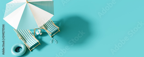 Top view Beach umbrella with chairs and beach accessories on blue background. summer vacation concept. 3d rendering © aanbetta