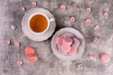 Wedding, St. Valentine's Day, birthday, preparation, holiday. Beautiful pink tasty macaroons on a concrete background - 244287325