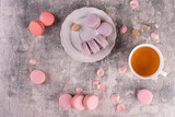 Wedding, St. Valentine's Day, birthday, preparation, holiday. Beautiful pink tasty macaroons on a concrete background - 244287518