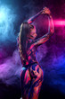 Leinwanddruck Bild - Young woman painted different colors. Inspired dance to music. Body art colorful. An amazing woman with art fashion makeup.