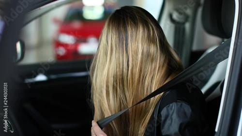 Fridge magnet Young woman fastening seat belt