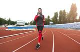 Arabian girl running on stadium - 244316765