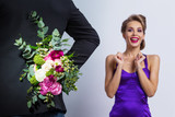 Man brings flowers to woman - 244330153