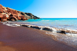 Red beach with turquoise water and volcanic sand on Santorini island, Greece.