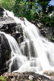 Vertical waterfall in rocks. Mountain river in mountains. - 244339118