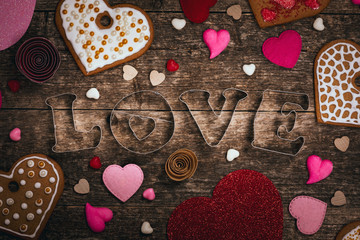 Love Valentines Day Background. Valentines Day Heart Shaped Cookies on Wooden Background. Selective focus. © Ali Safarov