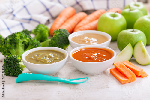 Baby food. Various bowls of fruit and vegetable puree