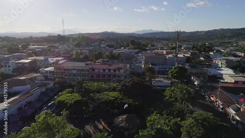 Sticker Backward Drone flight over the central park and main church of a  village in Central America