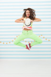 Glamour fashion model. Crazy girl in colorful sporty clothes. Happy and stylish sexy woman. Hip hop woman dancer. Fashion and beauty. Hipster girl. Confident in her choice. girl jump in yoga pose