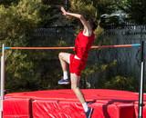 High jumper starting his jump - 244410308