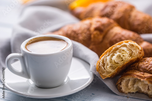 Fresh buttery croissants with coffee. Sweet morning breakfast concept. - 244410761