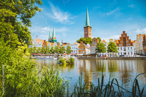 Leinwandbild Motiv Historic city of Luebeck with Trave river in summer, Schleswig-Holstein, Germany