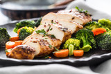 Roasted chicken breast with broccoli carrot and sesame - 244455518